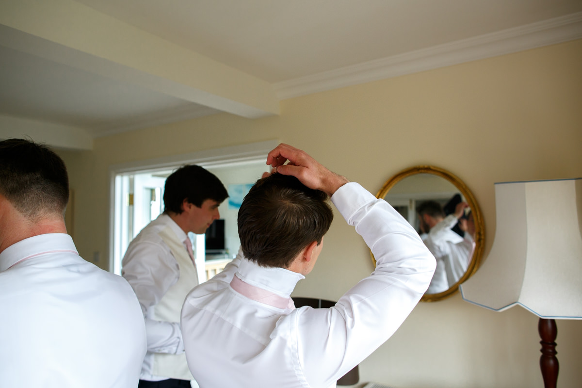 Simon the groom gets ready for his devon wedding