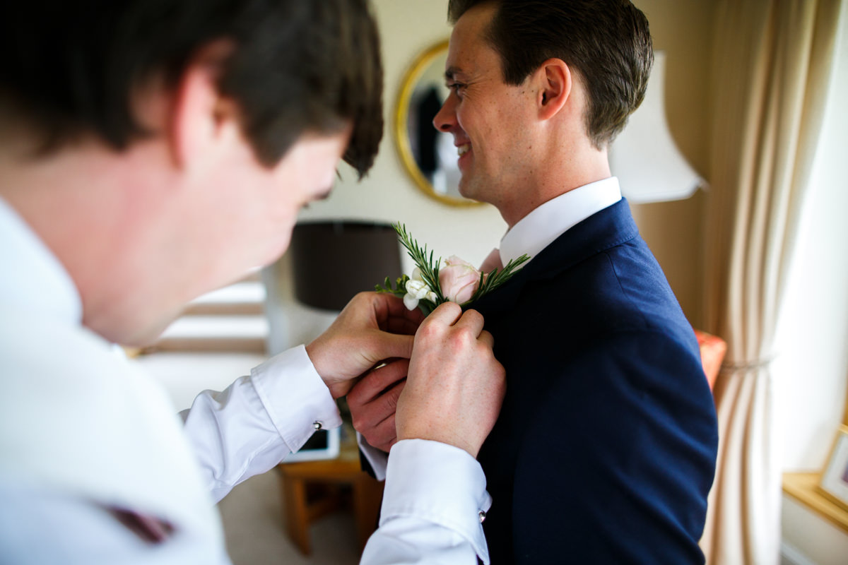 The buttonholes are attached ready for this Dittisham wedding