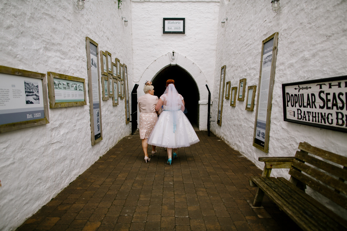 bride walks through the underpass at tunnels beaches