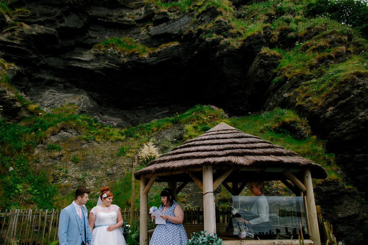 bride and groom during their ceremony at tunnels beaches