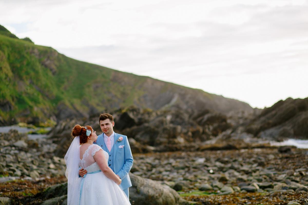 bride and groom on the beach at their Devon wedding venue