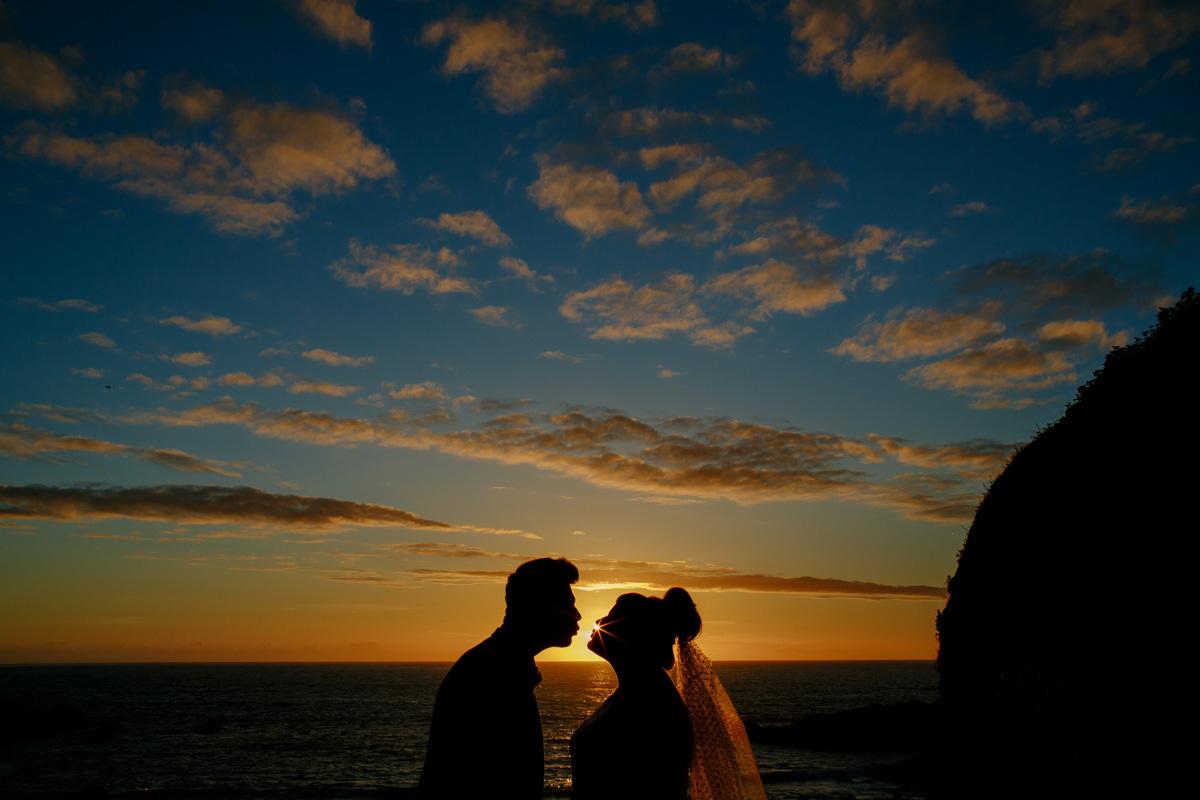 the sun sets on a tunnels beaches wedding