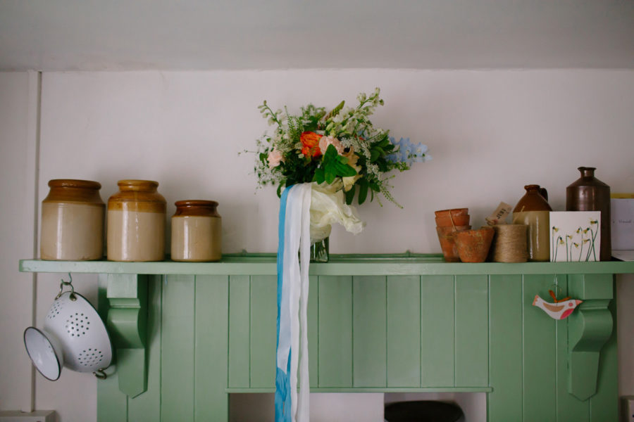brides bouquet on a shelf in their house in cornwall