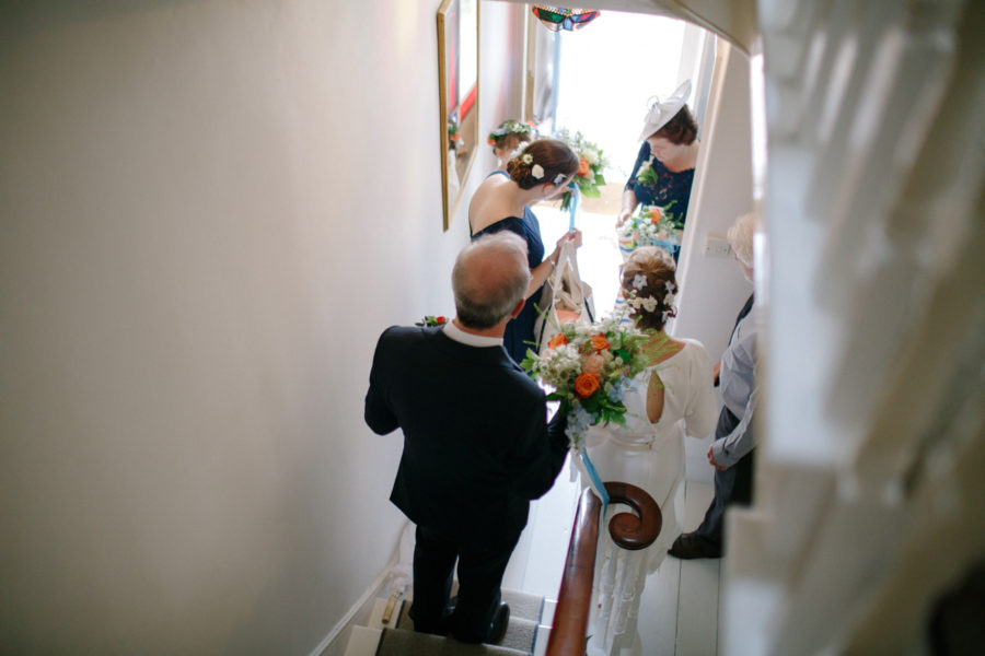 bride and bridesmaids prepare to leave their house in cornwall