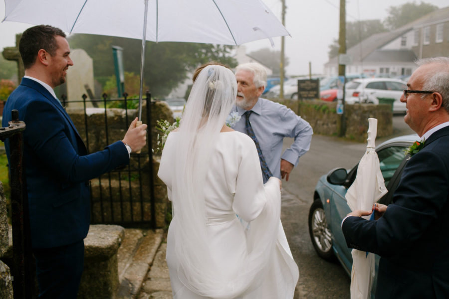 cornish bride arrives at church for her wedding