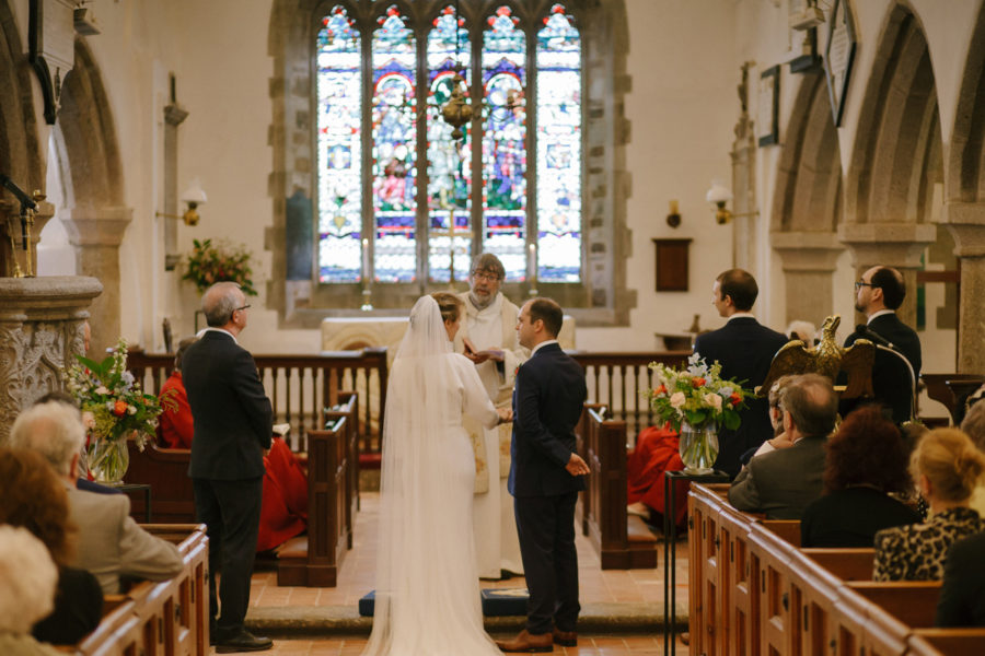 bride and groom in church for their Cornwall wedding