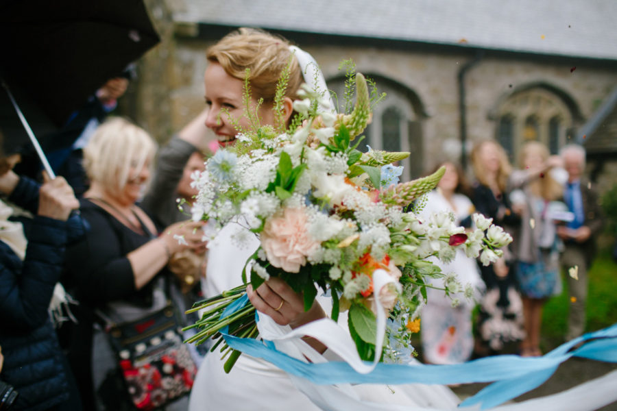 the brides bouquet looking splendid as she leaves church