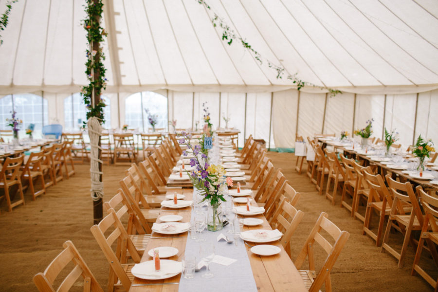 trestle tables set for a stunning marquee wedding reception