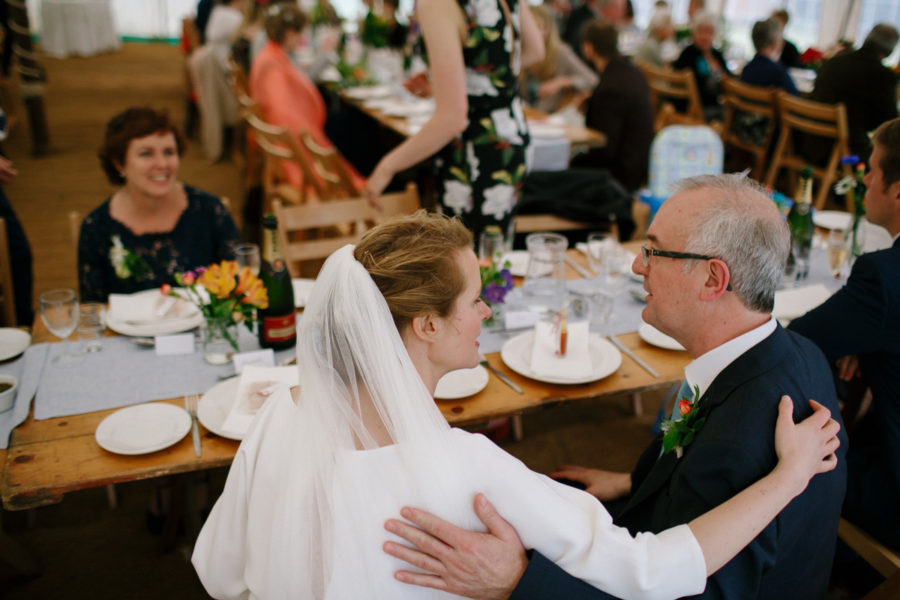bride hugs her father after her wedding in Cornwall