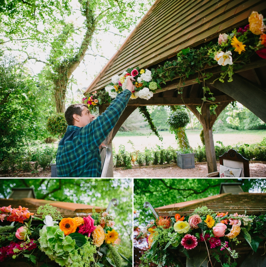flowers being set up for an outdoor wedding