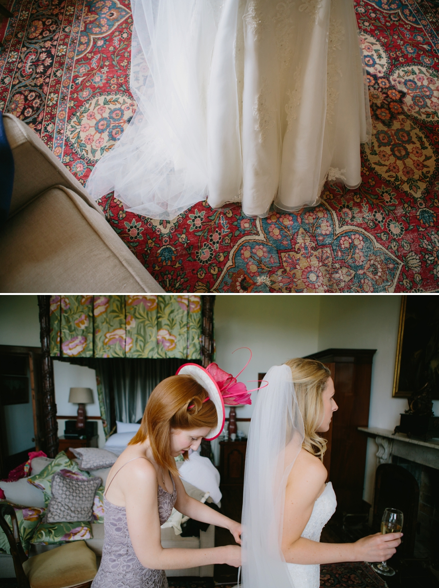 bride gets laced into her wedding dress