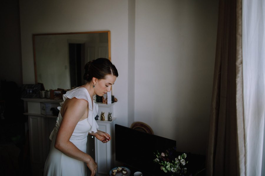 a bride takes a moment to reflect ahead of her Wandsworth wedding