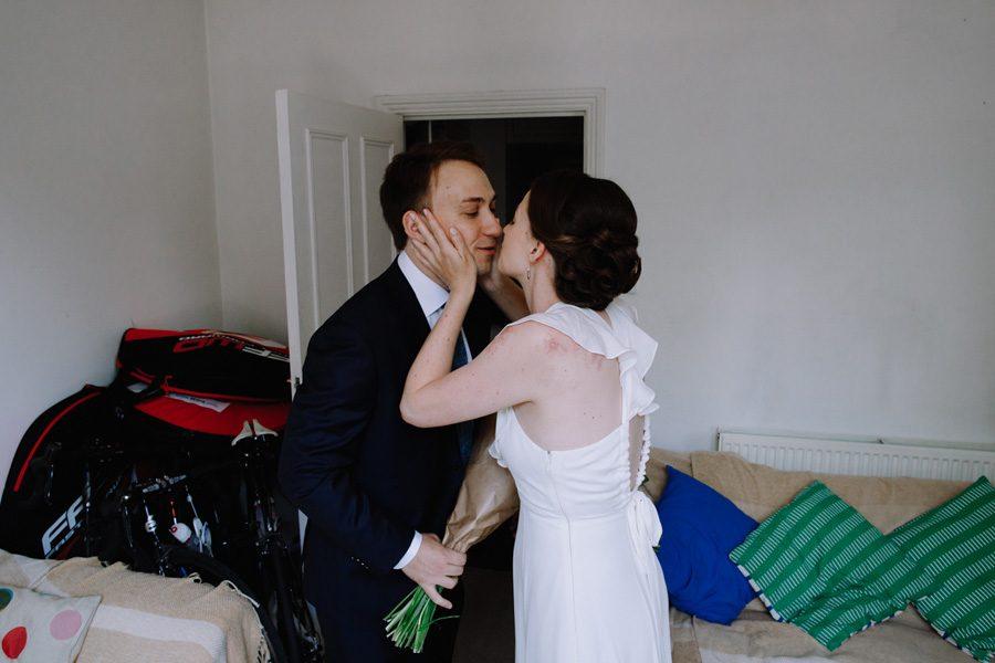 London bride kisses her husband before their wandsworth wedding