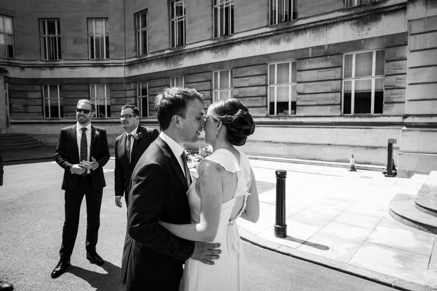bride and groom embrace before their wedding in London
