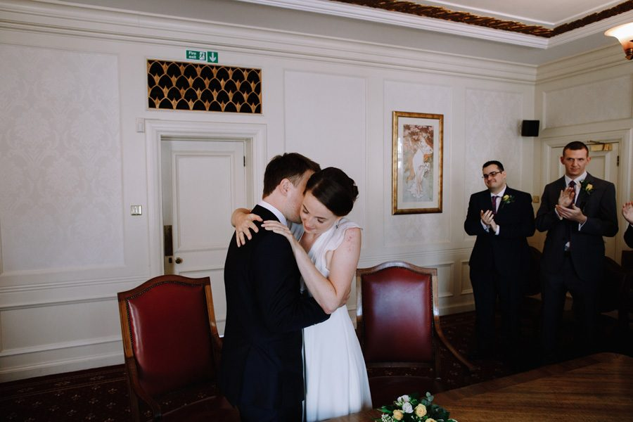 bride and groom hug after their wedding ceremony