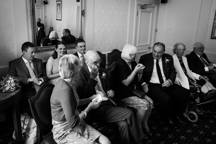 parents and guests wipe tears away at London wedding
