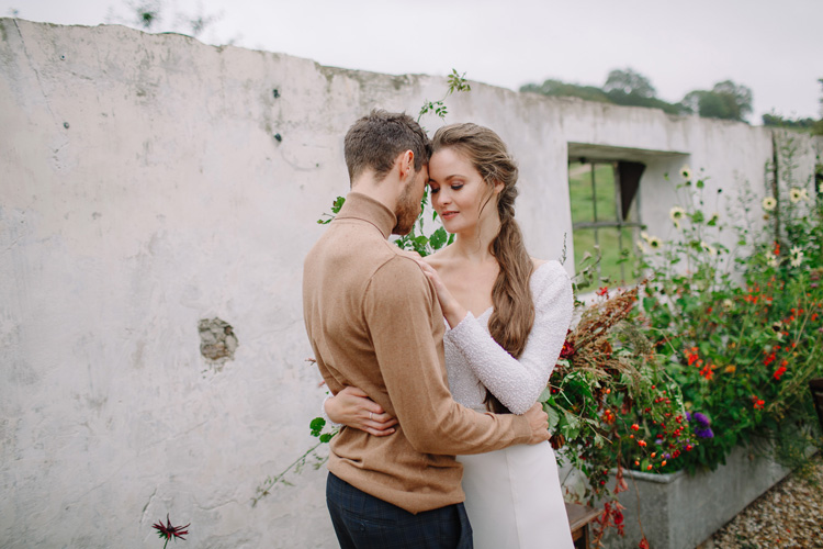 Bride and groom pose for photographs in a beautiful devon garden