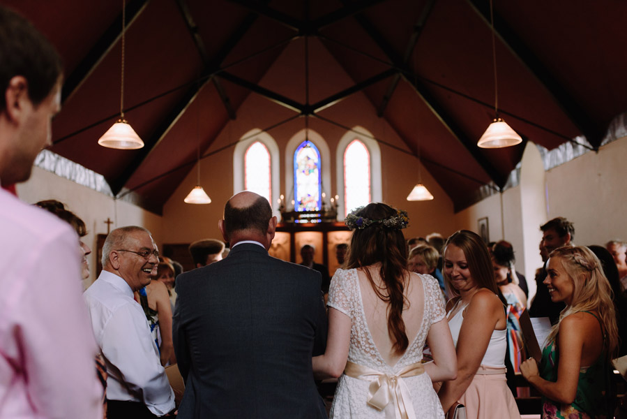 The bride enters church on her wedding day