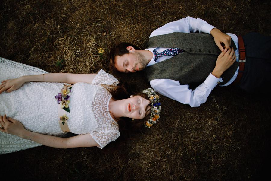 devon wedding photographer bride and groom lying down during their festival wedding