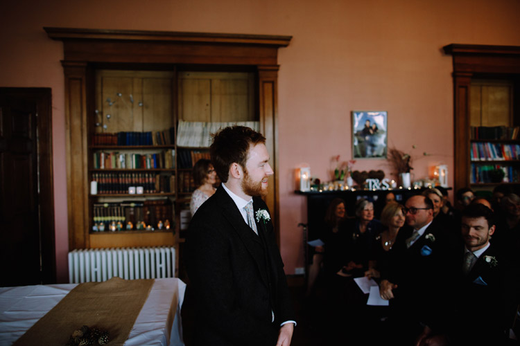 The groom waits for his bride at their wedding