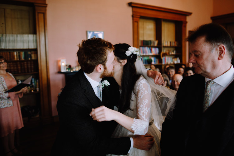 Bride and groom kiss ahead of their wedding ceremony