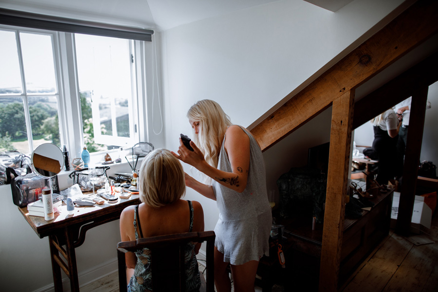Make up being applied to mother of the bride