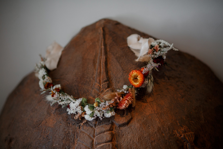 floral head dress ahead of Anran Devon wedding