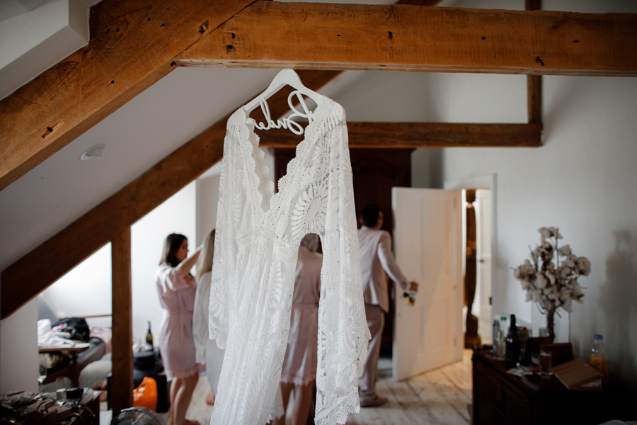 wedding dress hanging in room at anran devon