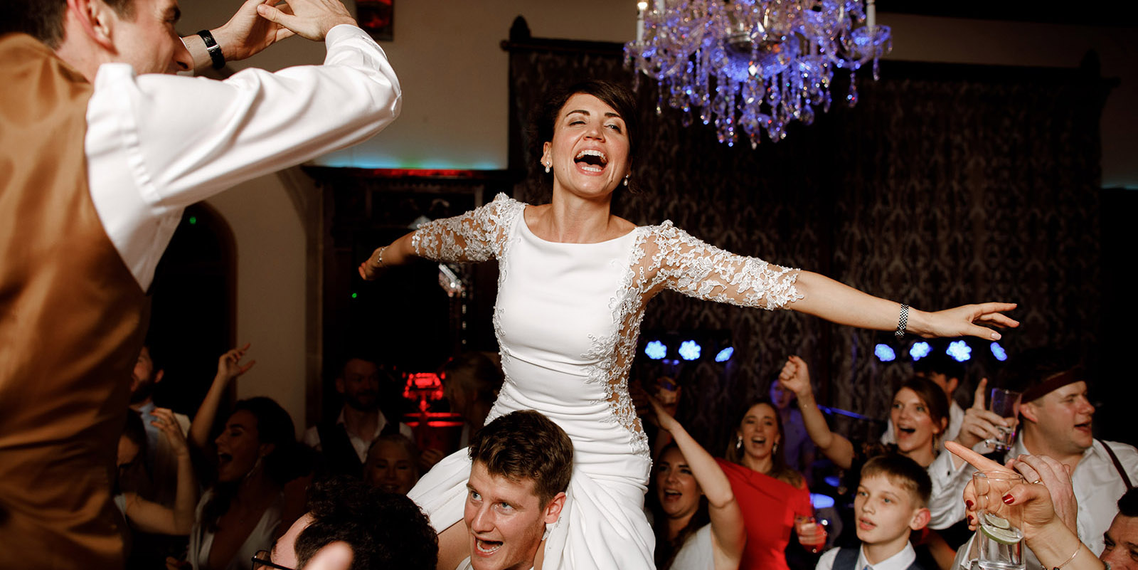 bride on grooms shoulders during evening reception at Huntsham court wedding