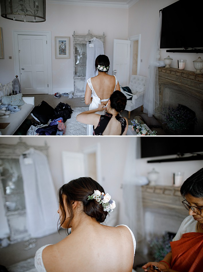 brides makes final touches to her dress ahead of her wedding ceremony