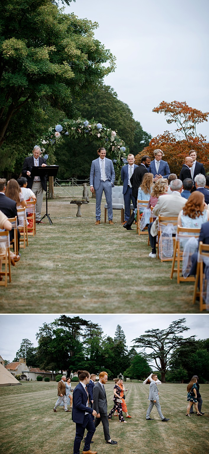 groom waits at the end of the aisle for this outdoor wedding