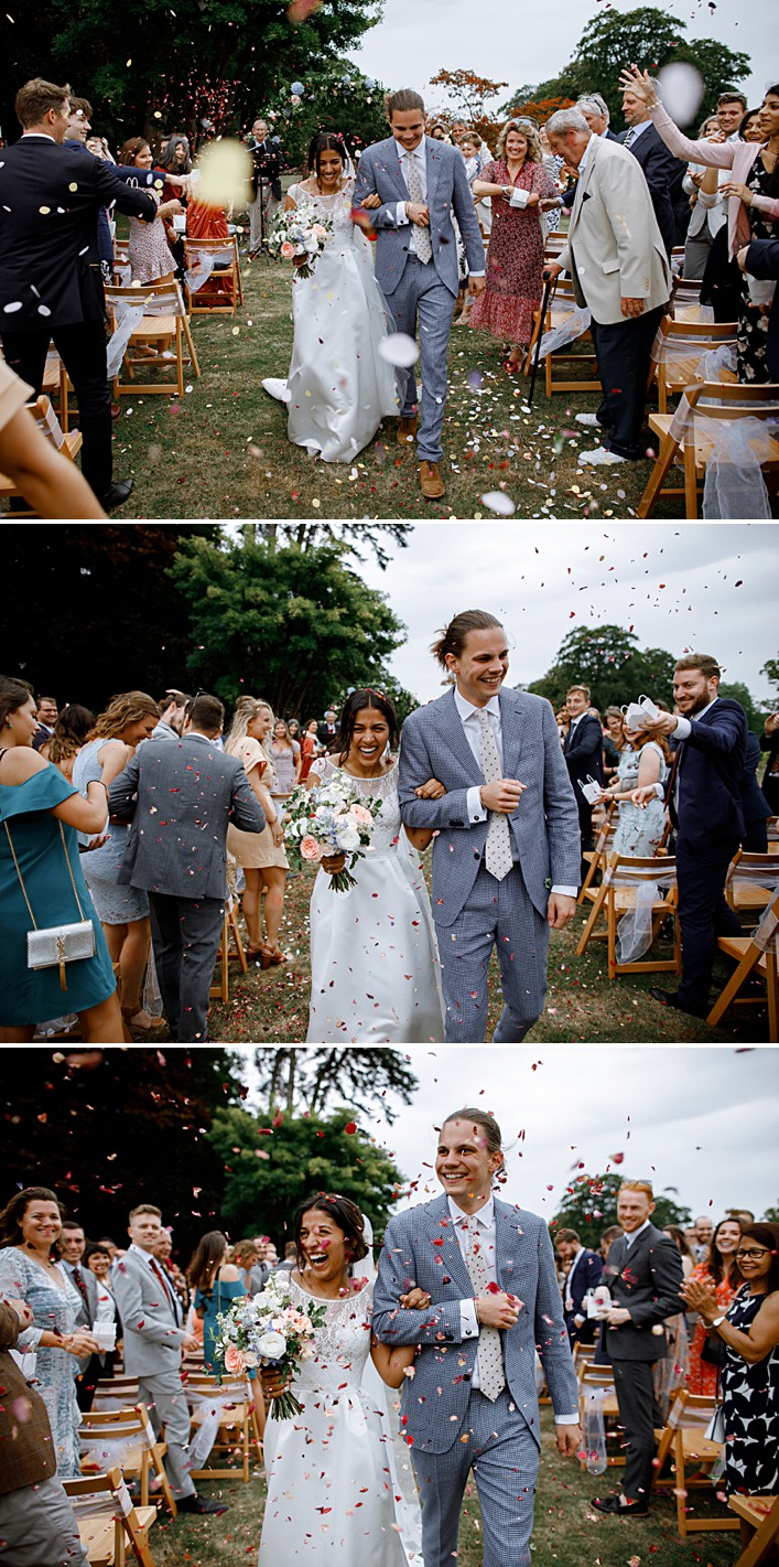 confetti showers the happy couple as they walk back down their garden aisle