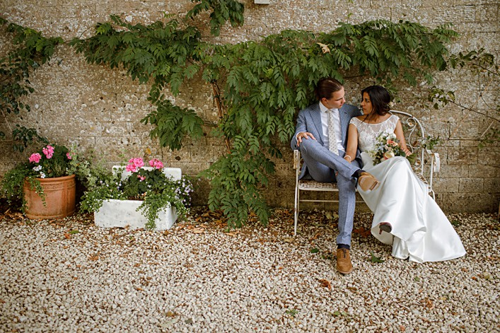 beautiful relaxed portrait of a bride and groom in a walled garden